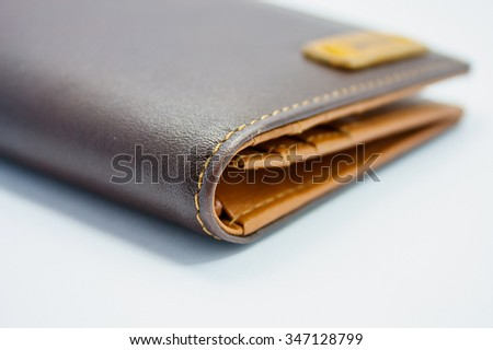 brown leather wallet on white background - stock photo