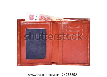 Brown leather wallet with 5000 ruble money - stock photo