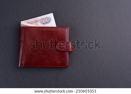 brown leather wallet with russian money on black background  - stock photo