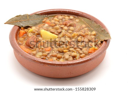 Brown lentil stew in bowl with vegetable - stock photo