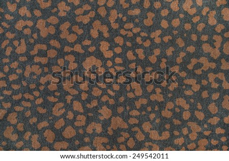 Brown leopard pattern on black. Spotted animal print as background. - stock photo