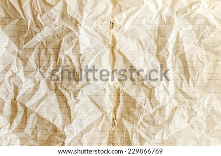 brown lined recycling paper , crumpled paper texture - stock photo