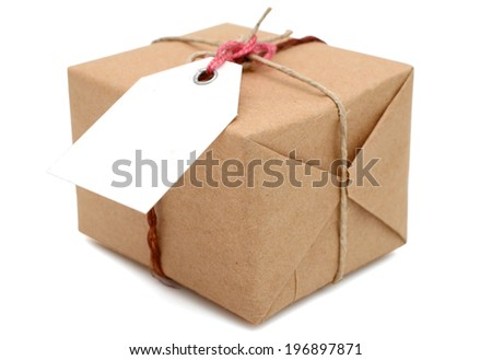 Brown mail package parcel wrap delivery with tag  - stock photo