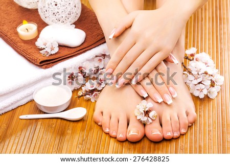 brown manicure and pedicure on the bamboo - stock photo