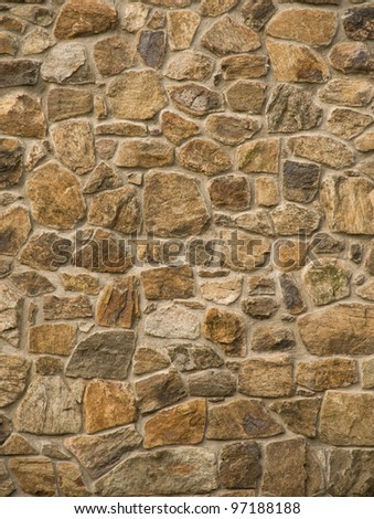 Brown masonry rock wall - stock photo