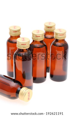 Brown medicine bottle on white background - stock photo