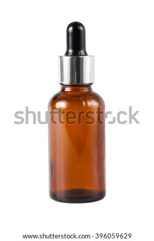 Brown medicine glass bottle with dropper isolated over white