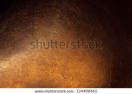 Brown metal surface with scratches closeup
