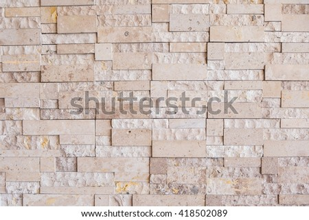 Brown modern stone wall background/texture.