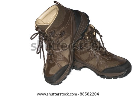 brown mountain boots isolated on a white background - stock photo