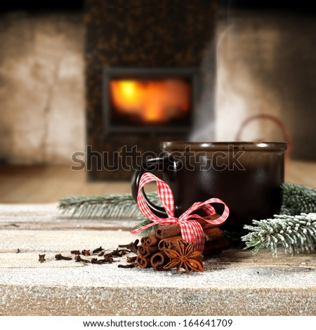 brown mug and fireplace on wooden desk  - stock photo
