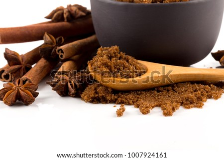 brown muscovado sugar in bowl isolated on white background