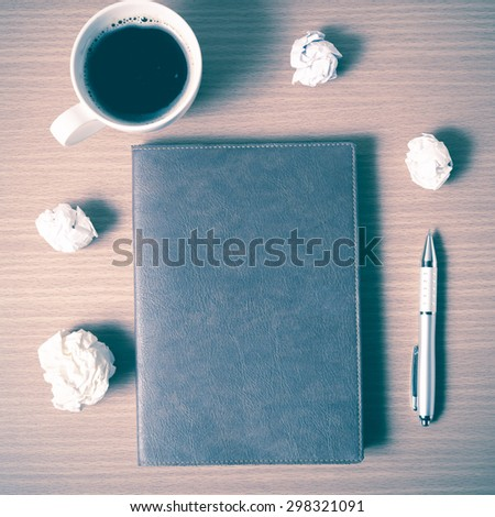 brown notebook and crumpled paper with coffee cup on wood background vintage style - stock photo