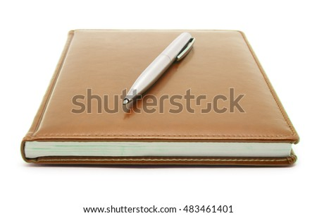 Brown notebook and pen isolated on white
