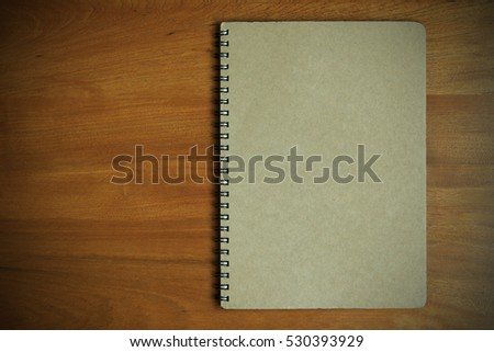 Brown notebook cover empty on wooden background