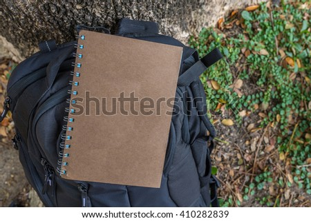 Brown notebook with backpack for nature concept
