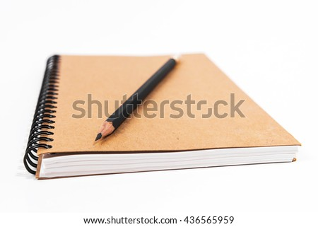 Brown notebook with black pencil on white background. Notebook isolated. Blank notebook.