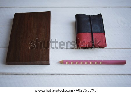 Brown Notebook with pensil on white wooden background.  - stock photo