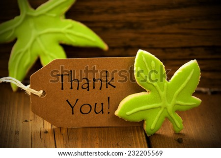 Brown Organic Label With English Text Thank You On Wooden Background With Two Leaf Cookies And Frame - stock photo