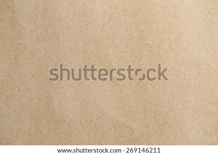 Brown paper, a little bit crumpled, cardboard texture for background. - stock photo