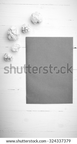 brown paper and crumpled on white table black and white tone color style