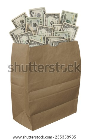 Brown paper bag filled with American money isolated over a white background
