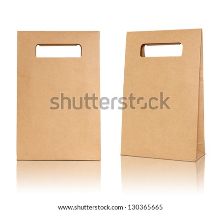 Brown paper bag on reflect floor and white background - stock photo
