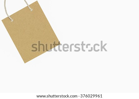 Brown paper bag on white background.Concept shopping bag