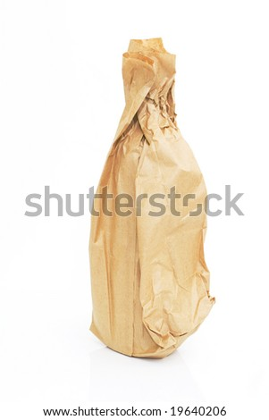 brown paper bag with a bottle isolated against white background - stock photo