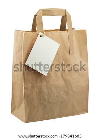 Brown paper bag with blank label for your personal message or company merchandising - stock photo