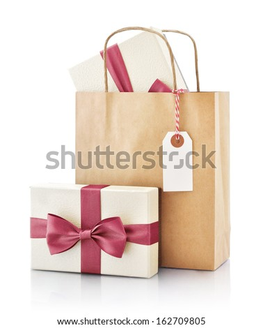 Brown paper bag with gift and paper tag isolated on a white background - stock photo