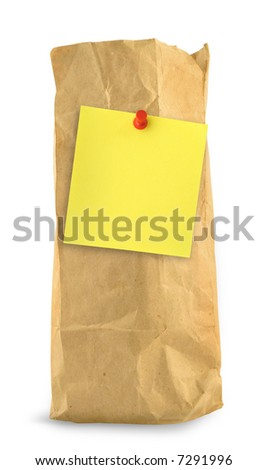 brown paper bag with yellow note against white background, small shadow at the left side - stock photo