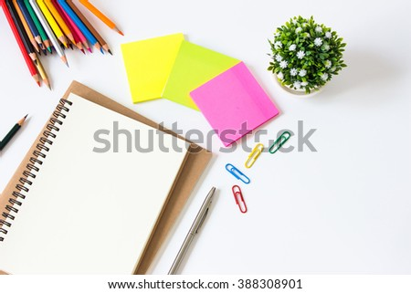 brown paper blank and paper note, color pencil, pen on white desk with copyspace / for your text or message, artwork / view from above, top view / business, office supplies concept - stock photo