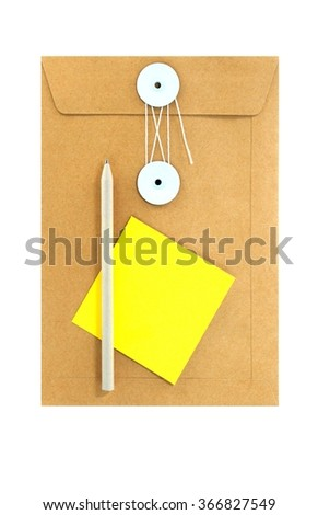 Brown paper envelope with pen and yellow note paper. Isolated on white background - stock photo
