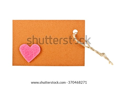 Brown paper label with pink heart on white background
