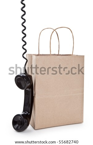 Brown paper shopping bag and telephone with white background