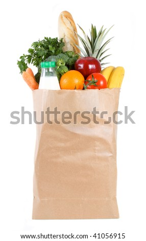 Brown paper shopping bag filled with fresh fruit and vegetables
