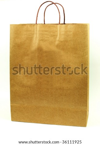 Brown paper shopping bag isolated over white background - stock photo