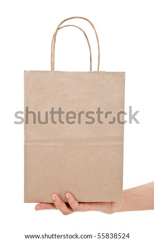 Brown paper shopping bag with white background - stock photo