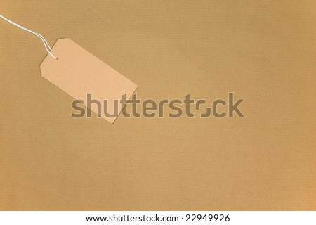 Brown paper with a blank tag on string.