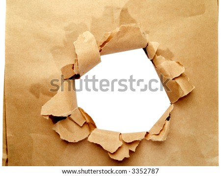 Brown paper with hole isolated on white - stock photo