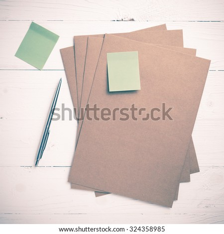 brown paper with sticky note on white table view from above vintage style