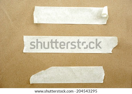 Brown paper with white tape for background - stock photo