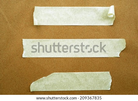 Brown paper with white tape for background