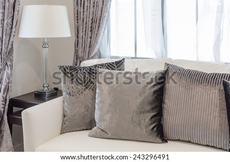 brown pillows on white sofa in luxury living room at home - stock photo