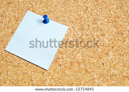 brown pin board with blue paper