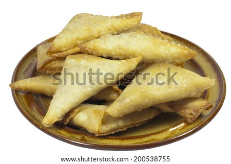 brown plate folded and freshly fried samosa snacks - stock photo