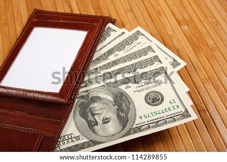 Brown purse on wooden table. - stock photo