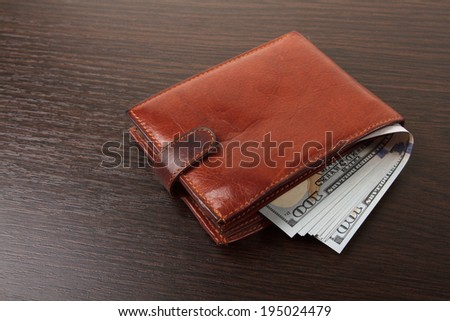 Brown purse on wooden table.