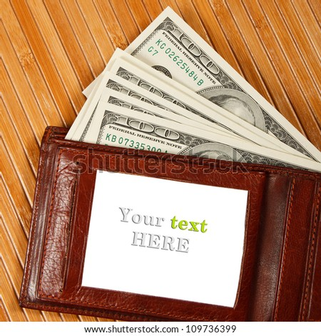 Brown purse on wooden table. Place for your text. - stock photo